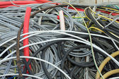 Tangle of insulated copper wire in a landfill — Stock Photo