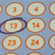 Foto Stock: Tab of lottery with circled number