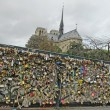 Padlocks of love on a bridge in Paris — Stock Photo