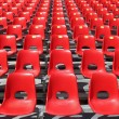 Red chairs of empty stadium but ready to accommodate the fans - Foto Stock
