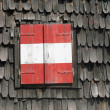Stock Photo: Red and white balcony of a mountain hut in the alps