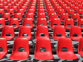 Red chairs of empty stadium but ready to accommodate the fans — Stock Photo