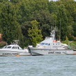 Ships of the financial police in the lagoon of Venice in Italy - Stock Photo