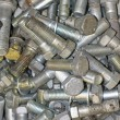 Pile of bolts of different sizes and many different sizes - Foto Stock