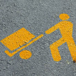Yellow man who load merchandise transport in asphalt — Stock Photo