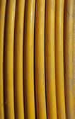 Yellow copper cable in a vertical coil — Stock Photo