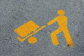 Yellow man who load merchandise transport in asphalt — Stock Photo