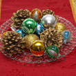 Red carpet with a nice Christmas decor with pine cones and shimm - Stock Photo