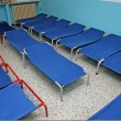 Camp beds and little beds for sleeping in a dormitory ofa nurse — Stock Photo