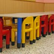 Stock Photo: Plastic chairs and a table in the refectory of the preschool chi