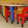 Stock Photo: Plastic chairs and table in refectory of preschool chi