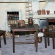 Stock Photo: Chairs and tables of a reconstruction of an ancient Italian peas