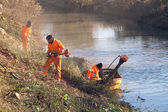 Workers at work during cleanup of the banks of the River — Stock Photo