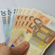 Stock Photo: Cash money in euro with hand of debtor