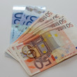 Money and euro banknotes with two wedding rings in gold are on t — Foto de Stock