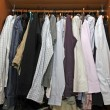 Stock Photo: Inside cabinet with many stylish shirts for men