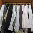 Inside a cabinet with many stylish shirts for men - Stock Photo