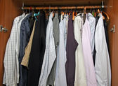 Open closet with many elegant shirts for important meetings — Stock Photo