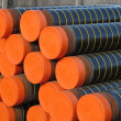 Piles of plastic pipes and conduits for transporting gas — Stock Photo #19946209