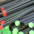 Piles of plastic pipes and conduits for transporting the  gas — Stock Photo