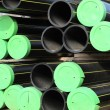 Stock Photo: Piles of plastic pipes and conduits for transporting gas