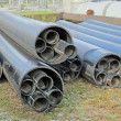 Stock Photo: Piles of plastic pipes for transporting water and gas