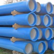 Piles of concrete pipes for transporting sewerage — Stock Photo #19946799