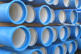 Piles of concrete pipes for transporting water and sewerage — Stock Photo