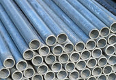 Pile of iron pipes for the transport of electrical cables and op — Stock Photo
