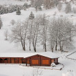 Stock Photo: Wooden chalet in Alps after heavy snowfall