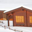 Stock Photo: Wooden mountain chalet in the Alps in Italy after a snowfall