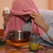 Stock Photo: Adult mwith towel breabalsam vapors to treat colds and fl