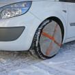 Tyres by car instead of socks to use snow chains for running saf — Stock Photo