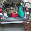 Car full of luggage before departure — Stock Photo