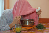 Man with pink towel breathe balsam vapors to treat colds and the — Stock Photo
