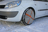 Tyres by car instead of socks to use snow chains for running saf — Stock fotografie