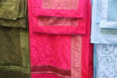 Three ethnic fabric fabrics to make clothes for special ceremoni — Stock Photo