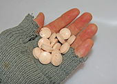 Hand of poor man holding a handful of medicines — Stock Photo