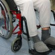 Patient with leg problems over the wheelchairs - Stock Photo