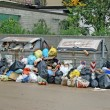 Bags of rubbish and waste bins in middle of road full of — Stock Photo #21440949