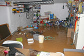 Garage with bike and boxes during a flood — Stock Photo