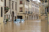 Cars in the streets and roads submerged by the mud of the flood — Stock Photo
