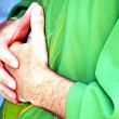 Stock Photo: Hands clasped in prayer priest