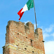Italian flag flying high above an tower — Stock Photo