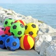 Rubber balls for sale on the Italian beach in summer - Stock Photo