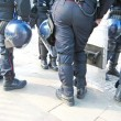 Stock Photo: Police in riot control by participants