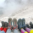 Stock Photo: Hiking boots of family rest on Dolomites