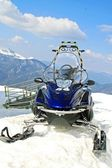 Snowmobile parked in the mountain on the snow — Stock Photo