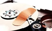 Patch to repair a broken hard drive hd — Stock Photo