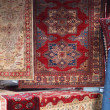 Street stall with resale of ancient Persian carpets - Foto Stock